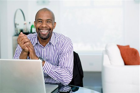 619-06399280 © Masterfile Royalty-Free Model Release: Yes Property Release: Yes Black businessman sitting with laptop